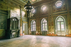 Empty hall in Sharovsky Castle with chandelier and fireplace Stock Images