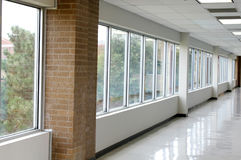 Empty hallway. Long hallway with large windows Stock Images