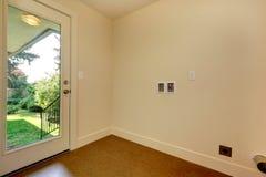 Empty hallway with glass door to backyard Stock Image