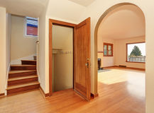 Empty hallway interior with hardwood floor. View of stairs to second floor Royalty Free Stock Image