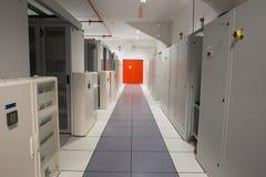 Empty hallway of server towers Stock Photos