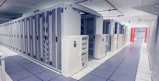 Empty hallway of server towers Stock Images