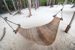 Empty hammock at  the beach Stock Photo