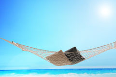An empty hammock with a couple of pillows on it Stock Photography