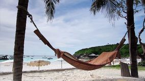 Empty hammock in an exotic beach. In tropic thailand stock video
