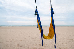 Empty hammock for fly-yoga or antigravity, aerial yoga on tropical beach background Royalty Free Stock Photography