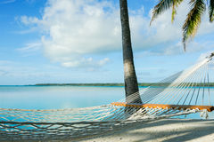 Empty hammock in idyllic setting. Royalty Free Stock Photos