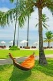 Empty hammock between palm trees Stock Photos