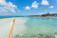 Empty hammock on tropical beach. In flamingo island. Aruba Royalty Free Stock Photos