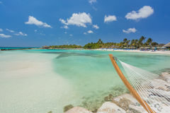 Empty hammock on tropical beach. In flamingo island. Aruba Royalty Free Stock Photo