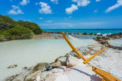 Empty hammock on tropical beach. In flamingo island. Aruba Royalty Free Stock Images