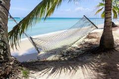 Empty hammock on a tropical beach Stock Photography