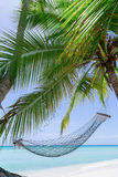 Empty hammock on a tropical beach Royalty Free Stock Photography
