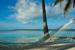 Empty hammock at waters edge. Royalty Free Stock Photos