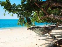Empty hammock  at white sand beach Stock Photo