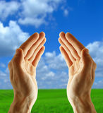 Empty hand. On sky background stock photos