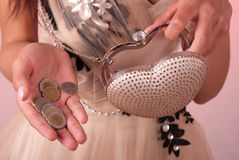 Empty handbag. Woman in an elegant dress with handbag Royalty Free Stock Images