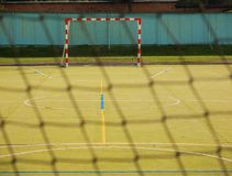 Empty handball gate. Outdoor football or handball playground, plastic light green surface on ground Stock Photography