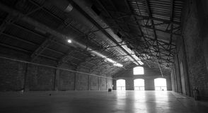 Empty hangar. Large empty hangar with light going through the windows royalty free stock photos