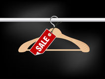 Empty hanger with sale tag Royalty Free Stock Photo
