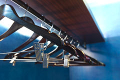 Empty hangers in a closet. Empty hangers in a deep blue closet stock images