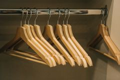 Empty hangers hang in a row in the closet.  stock photo