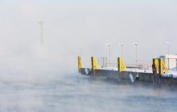 Empty harbor beside misty sea Stock Image