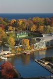 Empty harbour in autumn. Fall view of empty harbor with colorful trees along Lake Ontario Stock Photo