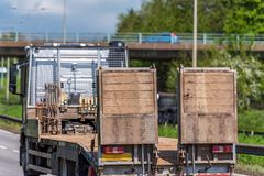 Empty haulage trailer truck on uk motorway in fast motion. Empty tilt trailer truck on uk motorway in fast motion stock photography