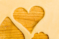 Empty heart in cookie dough Royalty Free Stock Images