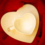 Empty heart shaped cup on red Royalty Free Stock Photography