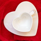 Empty heart shaped cup on red Royalty Free Stock Photo