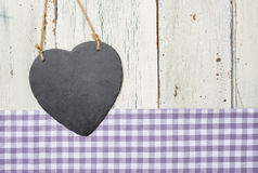 Empty heart-shaped sign on a wooden background Stock Photos