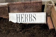Herbs. Empty herb garden with herbs sign stock photo