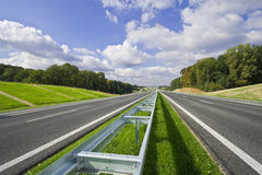 Empty highway. With blue sky Stock Photography