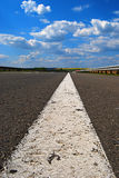 Empty highway. Empty road with white line and blue sky Stock Images