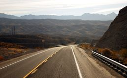 Empty highway. Mountain landscape - empty highway, clouds and the blue sky Stock Image
