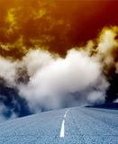 An empty highway. On a background of dense clouds royalty free stock photos