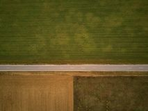 Empty highway from above through field and meadow royalty free stock photos