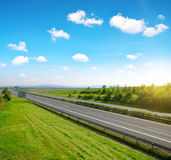 Empty highway with blue sky. In summer landscape Royalty Free Stock Images