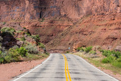 Empty highway in cañon and Mesa country of Southern Utah. Paved highway with no traffic in canyon and Mesa country of Southern Utah Stock Photography