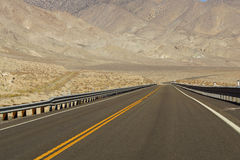 Empty highway in high desert Royalty Free Stock Images