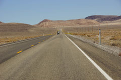 Empty highway in high desert Royalty Free Stock Image