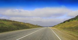 Highway landscape with moving cars at daytime. Empty Highway landscape without moving cars at daytime leading to horison Royalty Free Stock Photos