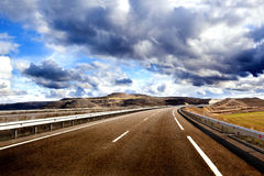 Empty highway,mountain landscape and cloudy sky.Road and car travel concept Royalty Free Stock Photos