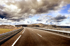 Empty highway,mountain landscape and cloudy sky.Road and car travel concept Royalty Free Stock Photo