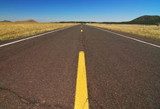 Empty highway road along the grand canyon. Photo empty highway road along the grand canyon Royalty Free Stock Photos
