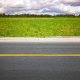 Empty highway. Roadside with green grass Stock Image
