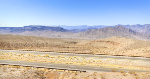 Empty highway in rural area of Nevada State. Royalty Free Stock Images