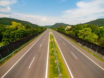 Empty highway on sunny day Stock Images